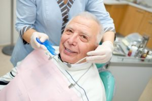 man learning about the basics of dental implants